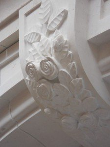 Hand carved roses at door surround